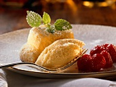 Souffle on a Plate with Raspberries and Fork