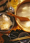 A wooden Bowl with Rice & cooked Rice