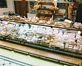 Assorted Cheeses at a Deli