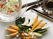 Decoratively Cut Vegetables on a Glass Plate