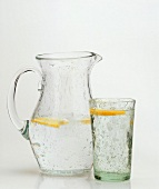 A Pitcher and a Glass of Water; Lemon Slices