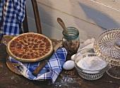 Pecan pie & ingredients on table