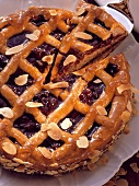 A Linzer tart with flaked almonds