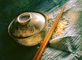 Painted rice bowl; chopsticks and rice