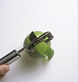 Peeling lime with vegetable peeler