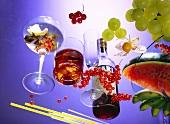 Campari; Fruit; Glasses on sheet of glass