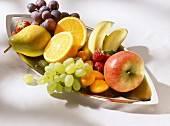 Assorted Fruits in oval Silver Bowl