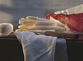 Wooden Table; White Asparagus; Prosciutto