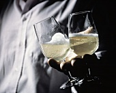 Two Glasses of Champagne in a Hand