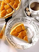 Piece of apricot tart with cream