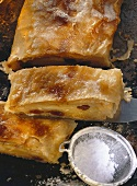 Viennese tray-baked apple strudel, a piece cut