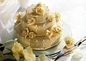 White wedding cake with marzipan roses
