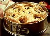 Sunken apple cake in the tin