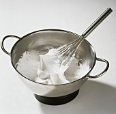 Whipped Egg Whites in Mixing Bowl; Whisk