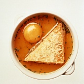Zuppa pavese (clear broth with raw egg yolk), Italy