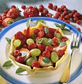 Baked fruit basket with fresh berries and grapes