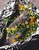 Trout au bleu on a Bed of Vegetables in Aluminum Foil