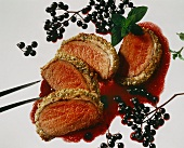Saddle of venison in a nut crust with elder sauce