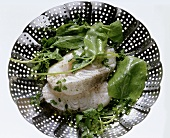 Whole cod & greens in a steamer