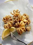 Deep fried squid with lemon wedge