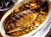 Carp in wine sauce with soup vegetables vegetable