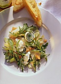 Delicate Fish Salad with Asparagus and Arugala on white Plate