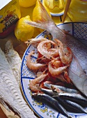 Assorted seafood still life with whole shrimp, sardines and fish coated with flour