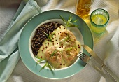 Salmon fillets in cream sauce with wild rice & red peppercorns garnish