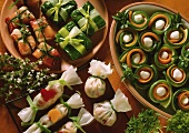 Assorted Appetizers of Mozzarella stuffed Zucchini and Carrot Rolls, stuffed Rice Paper Sacks and stuffed Ham and Spinach packages