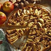 Apple tart with walnuts & raisins on glass platter