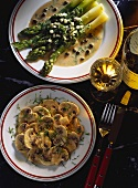 Green asparagus in oil & vinegar sauce with capers on plate