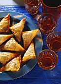 Cheese pasties on plate; decoration: filled glasses