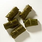 Five dolmades (stuffed vine leaves)