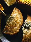 Fried pasties with spinach and sheep's cheese filling