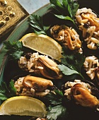 Mussels with rice and currant stuffing; lemon wedge