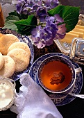 Romantic Tea Scene with Sugar Cookies; Flowers