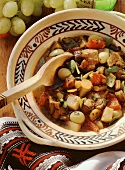 Romanian veal and vegetable stew with grapes