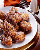 Small raisin doughnuts sprinkled with sugar