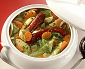 Abundant Vegetable Soup with whole Sausages in Tureen