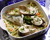 Cod pieces in a baking pan with vegetables & cream