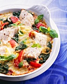 Fish gratin: cod fillets, tomatoes, onions and spinach