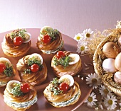 Several profiteroles filled with salmon & herb cream cheese