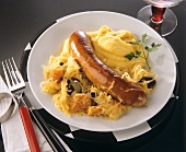One sausage with mashed potato and sauerkraut