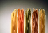 Several types of pasta: yellow, green, red, wholemeal spaghetti