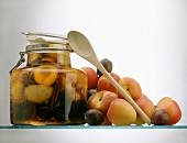 Stone Fruit Preserved in a Jar; wooden Spoon