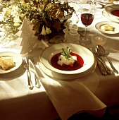 Christmas Table Setting with Red Beet Soup