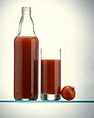 A Bottle and a Glass of Tomato Juice; Tomato
