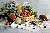 Assorted Fruit in a Basket and on Plates