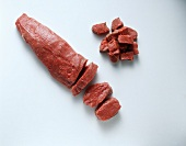 Beef fillet in the piece, slices and cubes