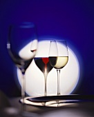 Three different wine glasses in front of a circle of light